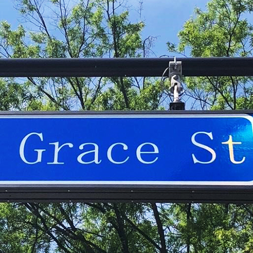 Street sign with the words Grace St.